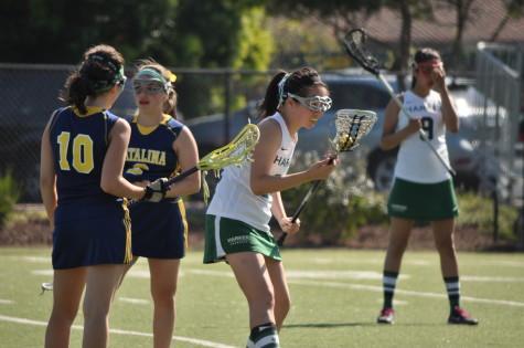 Varsity girls' lacrosse cradles their efforts to victory against Santa Catalina