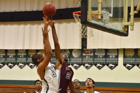 Varsity boys basketball defeats Eastside College Prep 64-53 in first league win