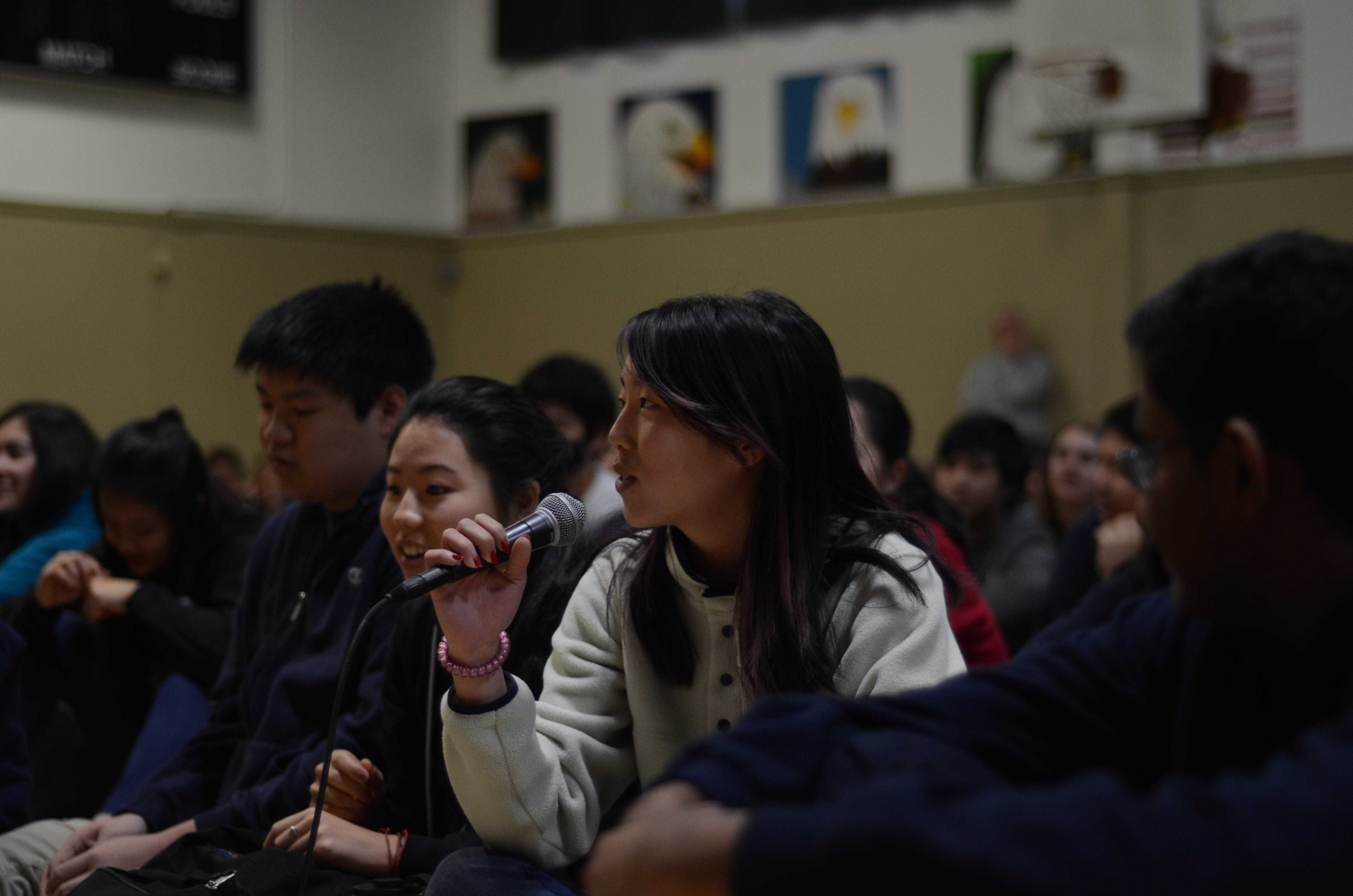 Kaitlyn Nguyen (11) asks candidate for ASB president Jimmy Lin (11) a question. Students were given the opportunity to pose any inquiries or concerns they had about the candidates' plans for the next school year following the speeches.