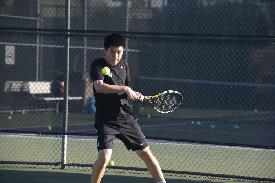 David+Wen+%2811%29+hits+a+backhand.+He+plays+number+one+singles+for+the+Harker+varsity+boys+tennis+team.+