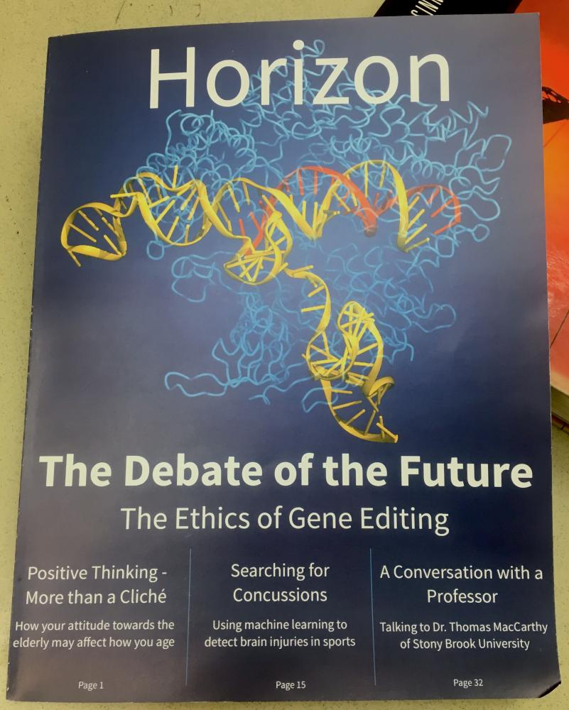 Science teacher and Harker Horizon adviser Chris Spenner's classroom copy of the first issue of Harker Horizon rests on a textbook. The issue, released last week, features science writing from current and past upper school students.