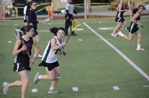 Girls' lacrosse team defeated by Pioneer Mustangs in season opener