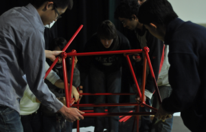 Engineering students participate in bridge-building assignment
