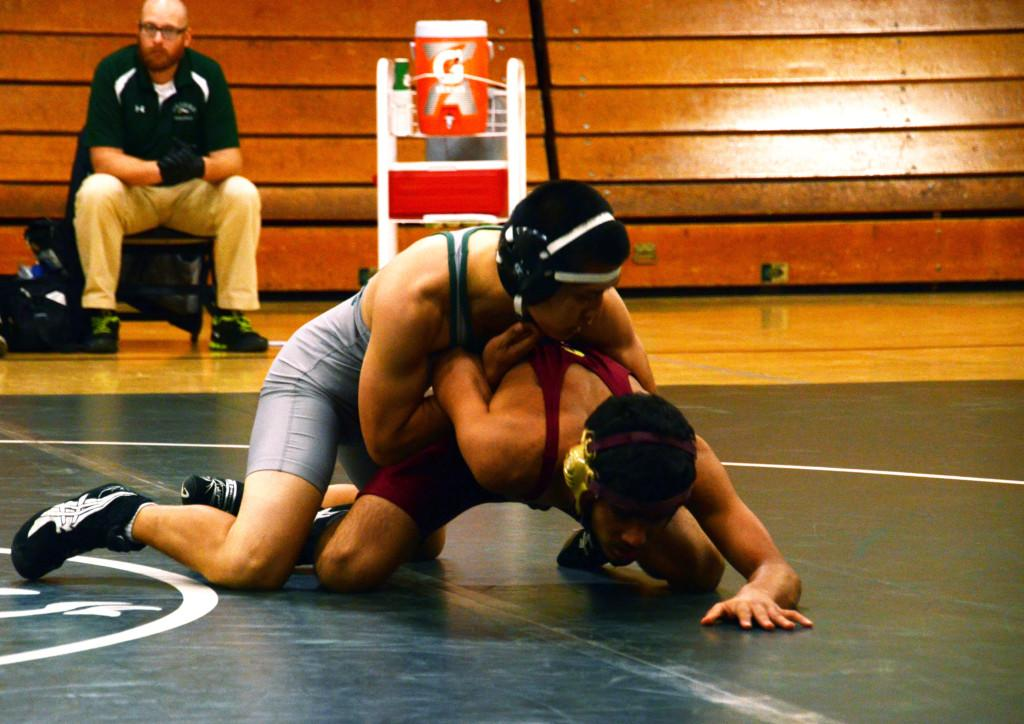 In the Blackford gym, Daniel Wang (12) wrestles against an opponent from Cupertino High School. He was honored as the only senior in the program on Thursday, January 31.