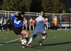 Sophomore Gabi Gupta kicks the ball past ICA's defender in a game on Friday, January 18. The Eagles' victory over ICA improves their overall record to 4-5-1 and 3-1-1 in league play.