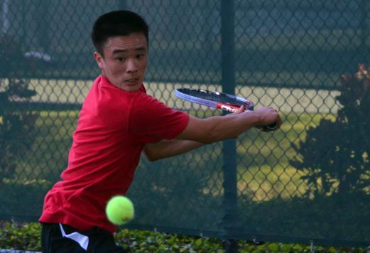 Sophomore Jason Chu prepares to hit the ball during the last home game against league front-runner Menlo. Despite strong performances, the team lost 0-7. However, the boys will keep practicing through next week because they qualified for CCS.