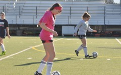 Varsity girls' soccer players Taylor Mahal (12) and Camille Piazza (12) began their tryouts with basic dribbling drills. Players also participated in small-sided games and transition exercises in order to demonstrate their skills to the coaches.