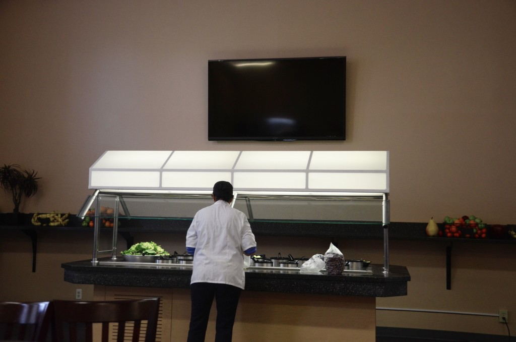 The bistro's back wall sports a new TV set for students' enjoyment. The salad bar was moved to the back of the bistro for easier access, and the fruit baskets were moved to either side of the TV, replacing their original location under the sandwiches.