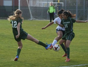 Joelle Anderson (9) and Nikita Parulkar (11) work together to keep the ball away from their opponent. The girls' lost their league playoff game against Kings Academy 2-1.