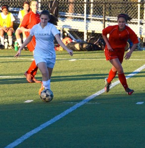 Lyndsey Mitchell (9) dribbles the ball down the field during the January 13 game against Castilleja. The girls are now league champions for the first time in school history.