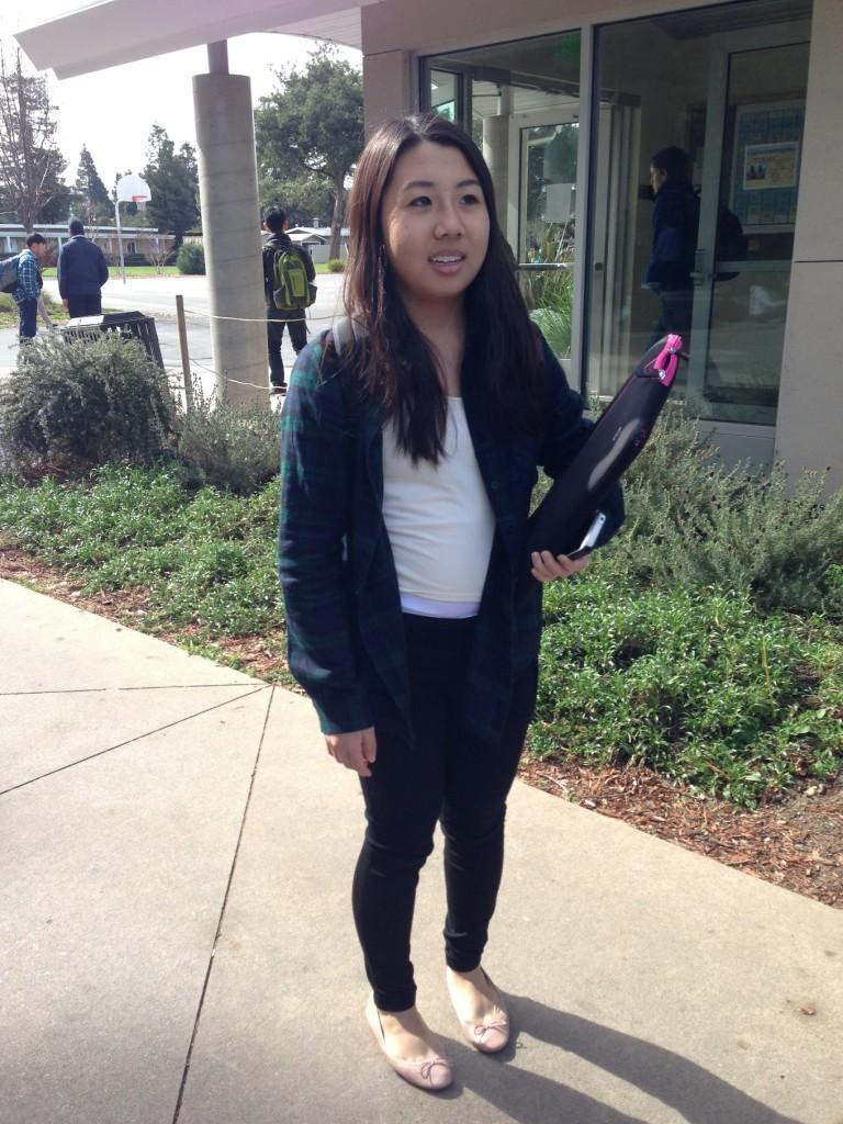 Helen Xie(10) wear layers of T-shirts and jackets on a sunny California day.