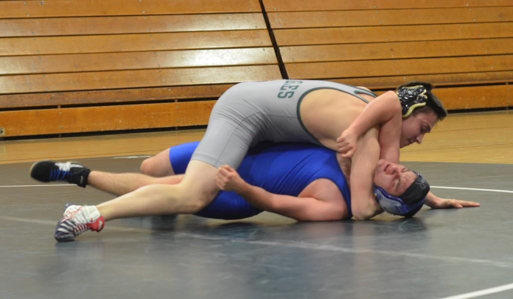 Darian Edvalson (12) pins down his opponent during a round his senior night. Darian has advanced to CCS and will compete next week.