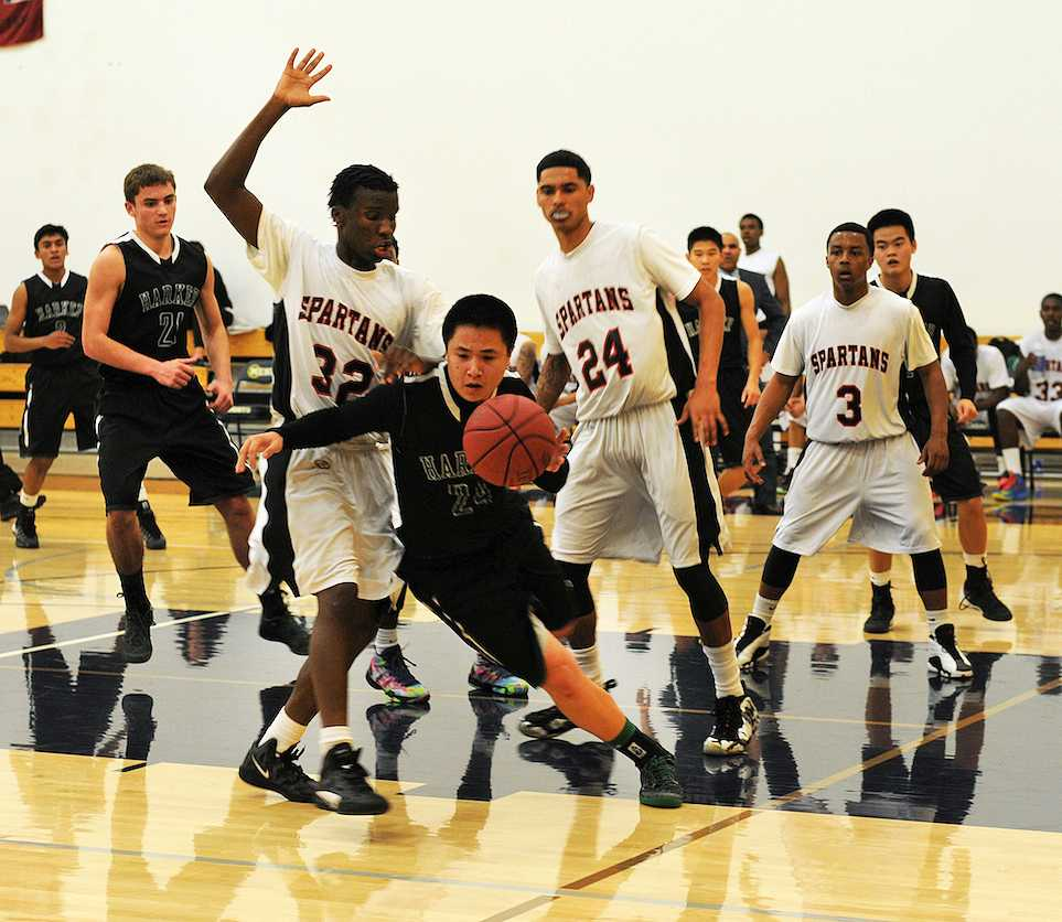 Nicholas+Nguyen+%2811%29+dribbles+to+the+basket+in+the+Harker+vs.+Seaside+Spartans+game+where+the+Varsity+Boys%27+Basketball+team+won+71-61.