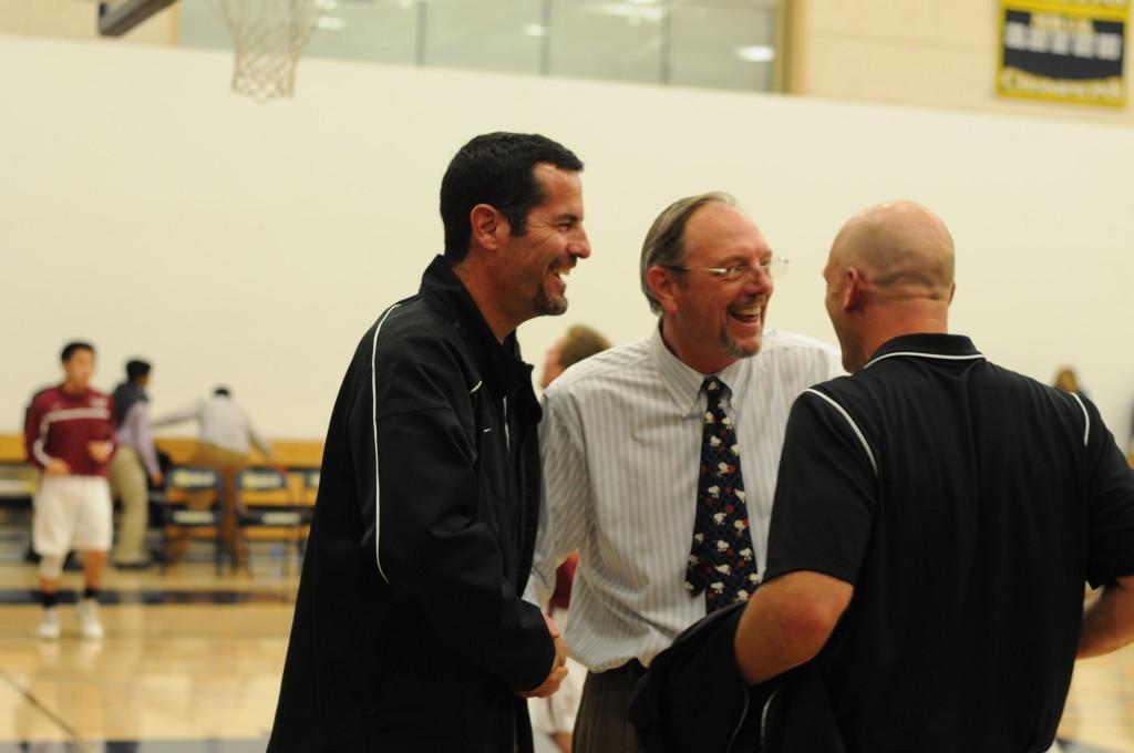 Upper+School+Athletics+Head+Dan+Molin+%28left%29+and+Head+Coach+Butch+Keller+%28right%29+receive+congratulations+after+the+Harker+vs.+Seaside+Spartans+game.+The+Varsity+Boys%27+Basketball+team+won+71-61.+