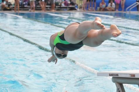 Swimmers participate in girls swim meet