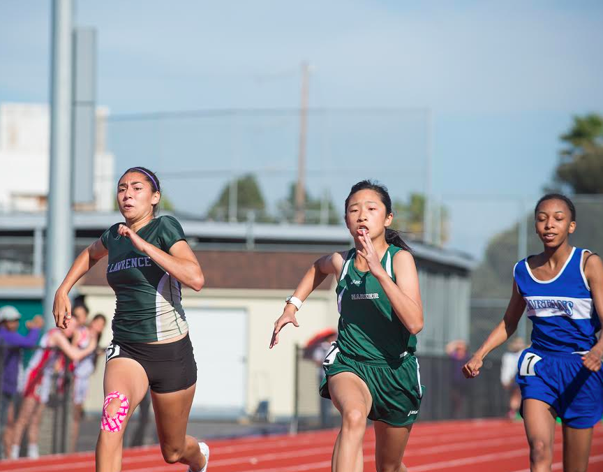 Freshman Winnie Li runs in the first heat of the girls 100 meters race against girls from St. Lawrence, Mercy SF, and Pinewood. Winnie also ran in the 4x100 relay earlier in the meet.