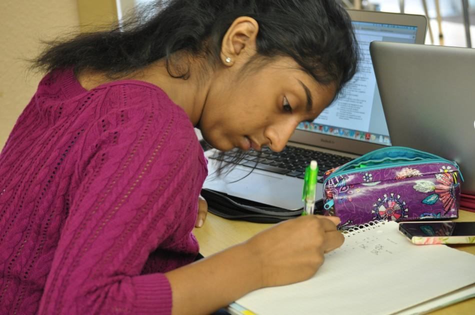 Natasha Santhanam (10) does math homework in the Edge after school. Although cramming for AP's was common, students still needed to complete homework assignments like normal.