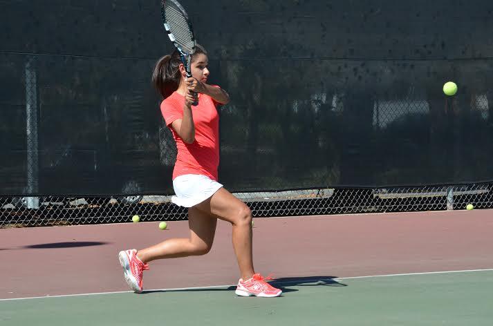 Maya Valluru (10) follows through with her backhand. Girls Varsity tennis  plays their first game on September 11 against Wilcox High School.