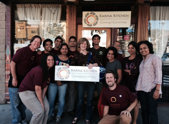Math Bradley Stoll and Visesh Gupta ('12) stand with other volunteers at Karma Kitchen, a community kitchen where they dedicate their Sundays to prepare food.