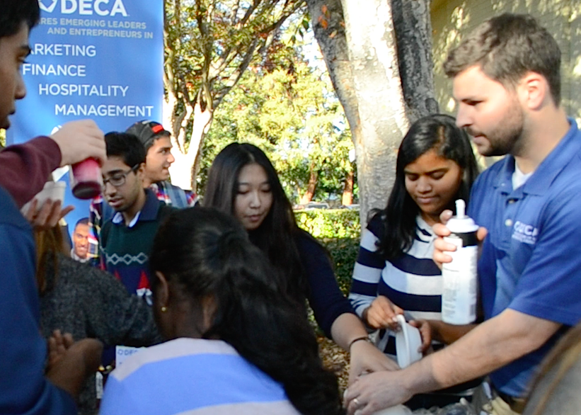 DECA+officers+hand+out+bowls+of+ice+cream+outside+Manzanita.