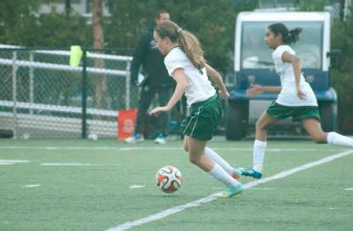 Kailee Gifford (10) dribbles the ball closer to the goal. The varsity girls soccer team tied 2-2 with Lynbrook High School today.
