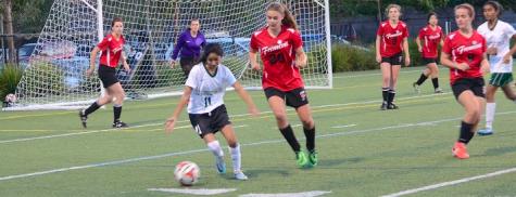 Nikita Parulkar (12) dribbles the ball away from her opponent. The girls' varsity soccer team loses against Fremont High School 3-4.