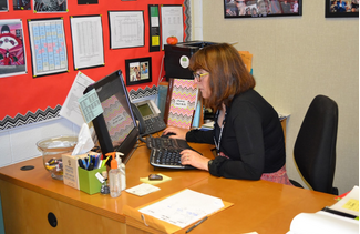 The attendance coordinator, Sue Prutton works at her desk. Tardies and absences have many consequences for students when appearing in multitudes.