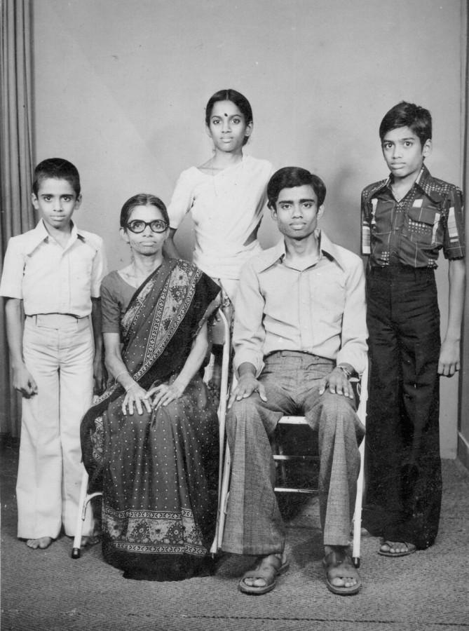My dad (seated, right) poses with his three younger siblings in this formal photo.