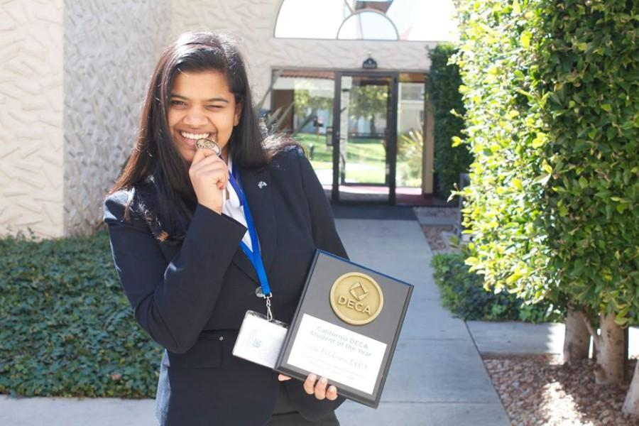 Savi+Joshi+poses+with+her+plaque+and+medal+at+the+California+Career+Development+Conference.+Savi+won+California+DECA+Student+of+the+Year+at+the+conference.