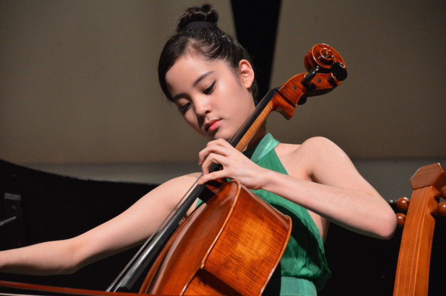 Nana focuses as she plays her piece. She performed at a United States International Music Competition Benefit Concert on March 21.