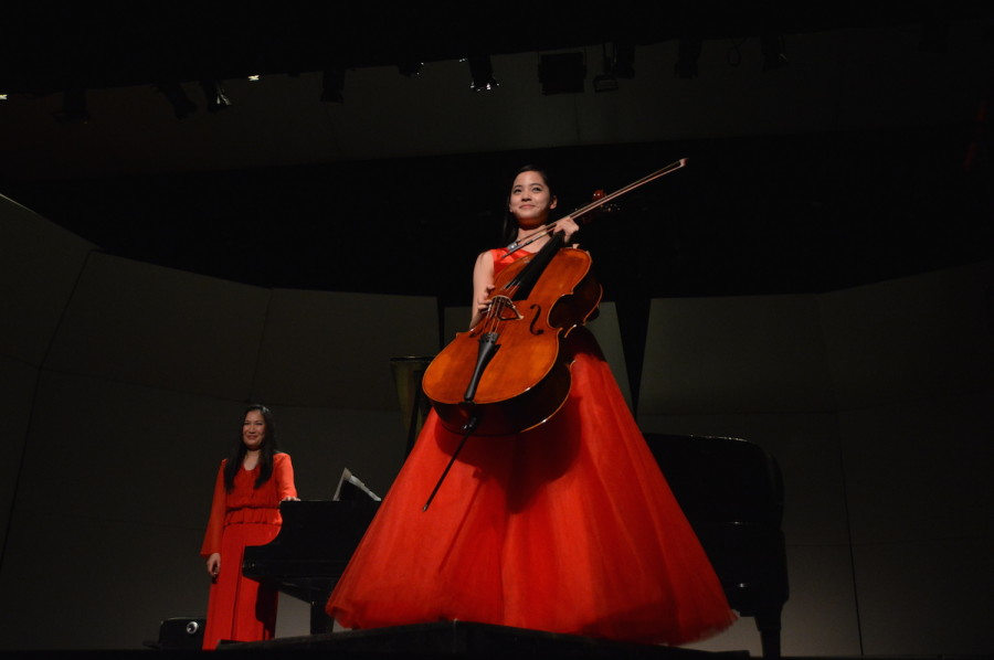 Nana and Jo-Hwa Yao smile at the audience after they finish their piece. She performed at a United States International Music Competition Benefit Concert on March 21.