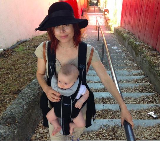 Alexandra Rosenboom holds her 22 month boy. Ms. Rosenboom will leave on maternity leave.