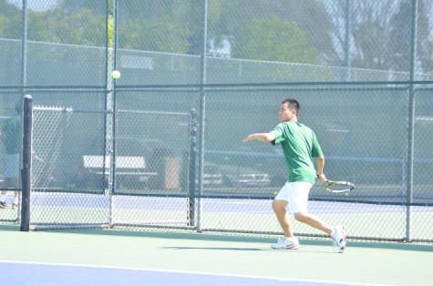 Albert Pun (10) prepares to hit a forehand. He and Edward Tischler won their doubles match against SHP.