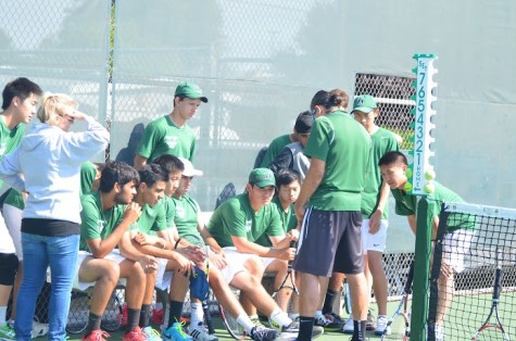 Coach John Fruterro gives the Varsity Tennis Team a pep talk before their game. They won 5 out of the 7 matches against SHP.