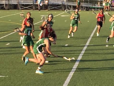 Girls' varsity lacrosse defeats Aragon High School