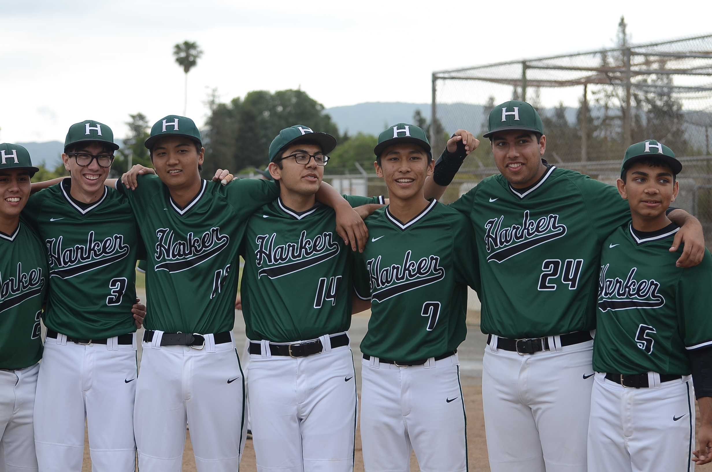 3) The seniors stand together to take a group photo on their last game. Boy's baseball held their senior night on Thursday, May 7.