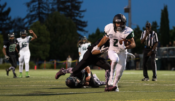 Johnathan Keller (12) avoids being tackled by Yerba Buena defense. The Eagles lost 21-38.