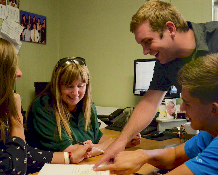Activities Coordinator Kerry Enzensperger, Assistant to Activities Coordinator Eric Kallbrier, President Layla Walker (12) and Vice President Arben Gutierrez-Bujari (11) gather in Kerry's room to discuss upcoming spirit events. The leadership team also collaborates with all class Spirit Coordinators so that students of each grade can participate as much as possible.