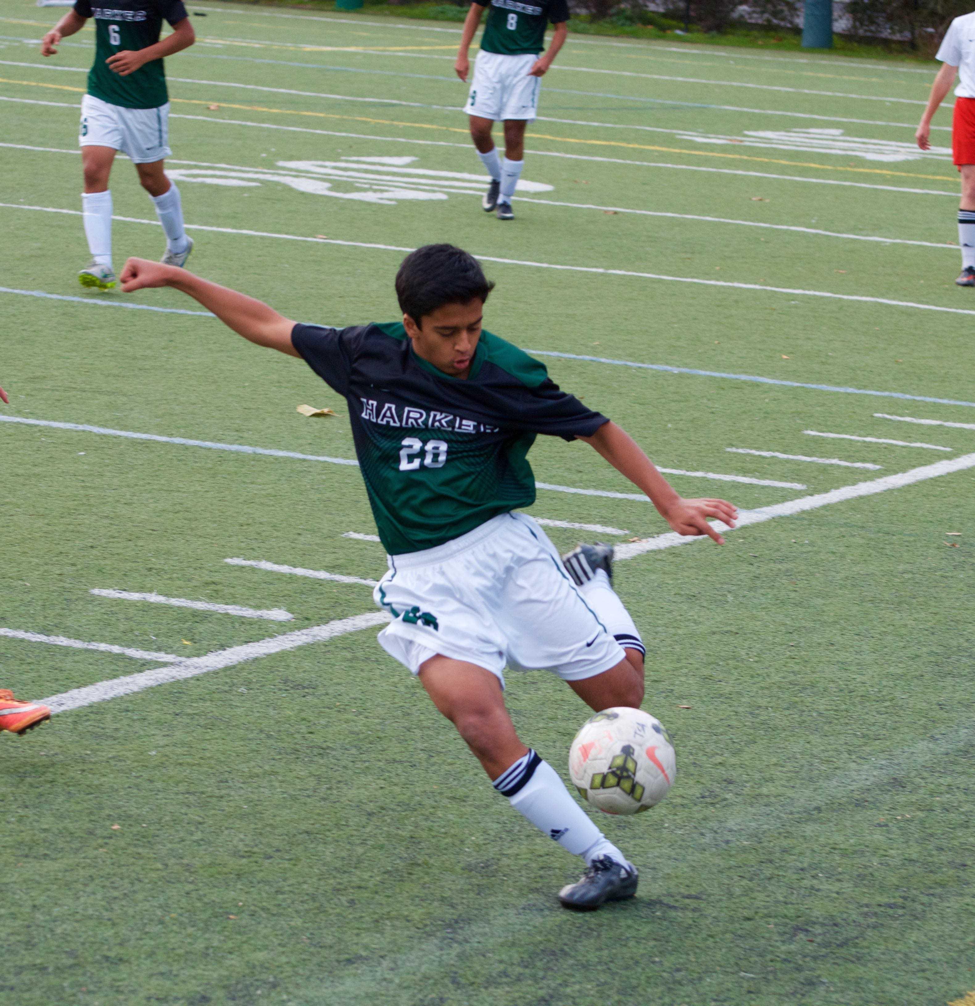Sophomore Rohit Shah kicks the ball far past midfield.  The varsity team lost to Saratoga High.