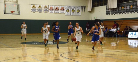 Kailee Gifford (11) steals the ball during varsity basketball team's match against Crystal Springs.