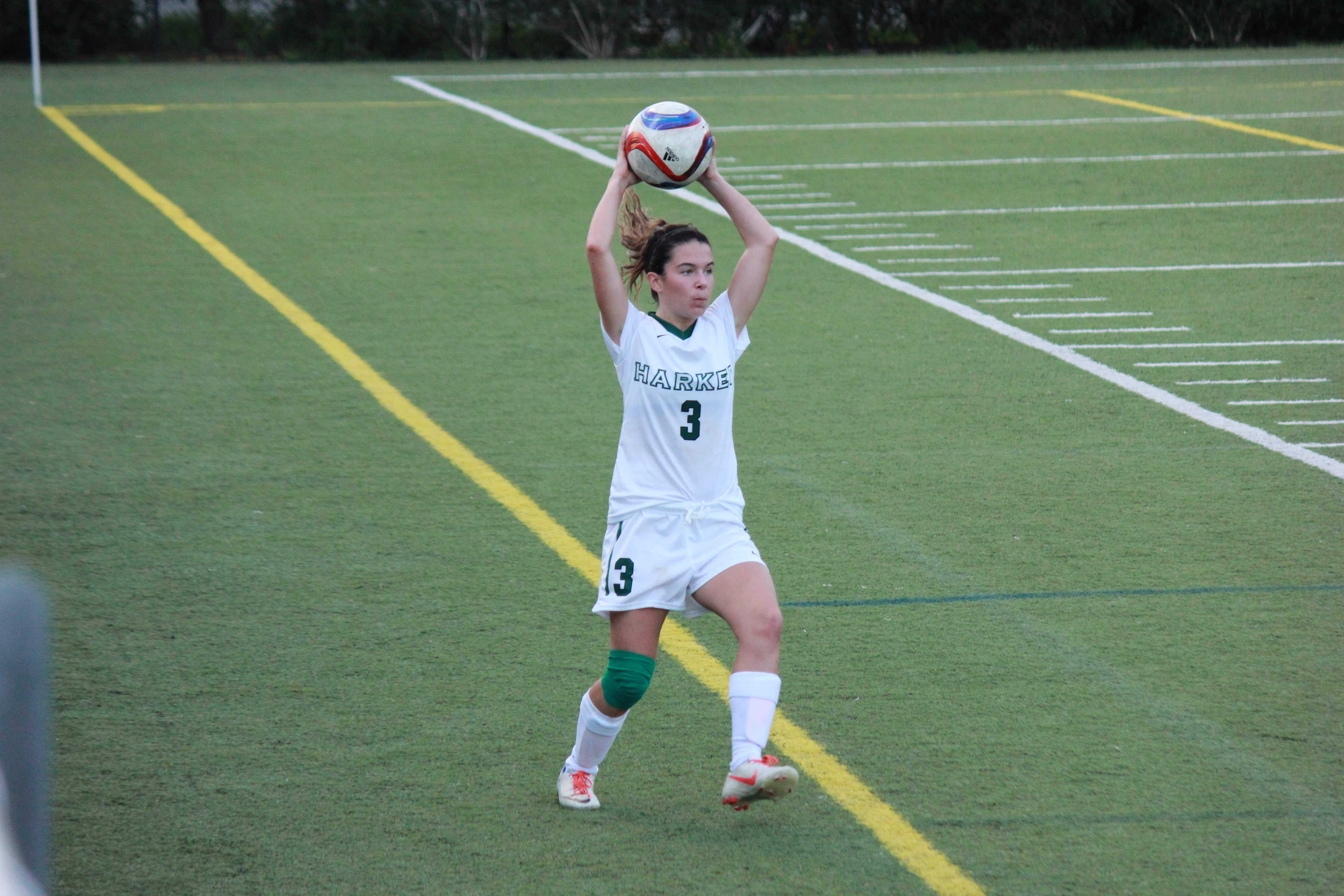 Junior Stephanie Scaglia prepares to throw the ball in during the team's match.