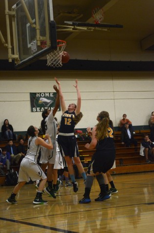 Freshman Prameela Kottapalli attempts to block the shot by a King's Academy player. The girls lost the game by four points.