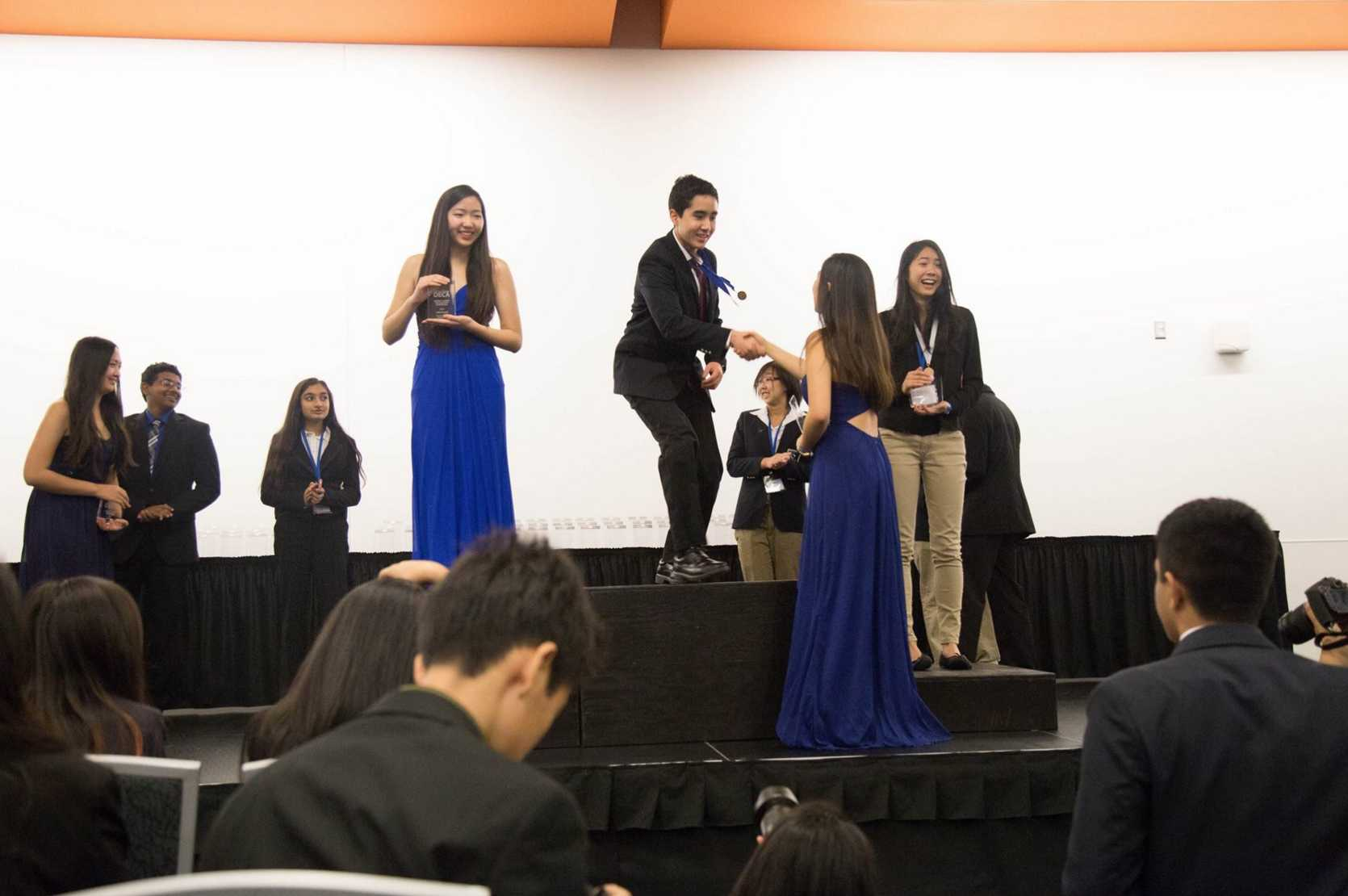 Chris Hailey (11) receives an award during the awards ceremony at the conference. Harker DECA will host a study session in preparation for the state conference this Friday at the Innovation Center.