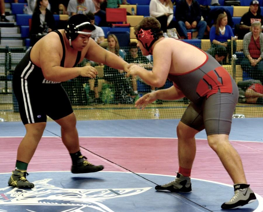 Davis Howard (11) stays alert as he attempts to find a way to attack the opponent. Davis placed 5th in his weight class at the Jim Root tournament at Prospect.