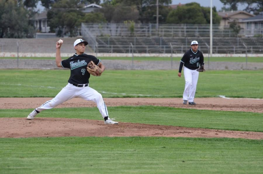 Nate+Kelly+%2810%29+lunges+forward+in+preparation+to+throw+a+pitch+during+the+second+inning.+Nate+was+one+of+three+Sophomores+to+pitch+during+the+game%2C+alongside+Akhil+Arun+and+Dominic+Cea.