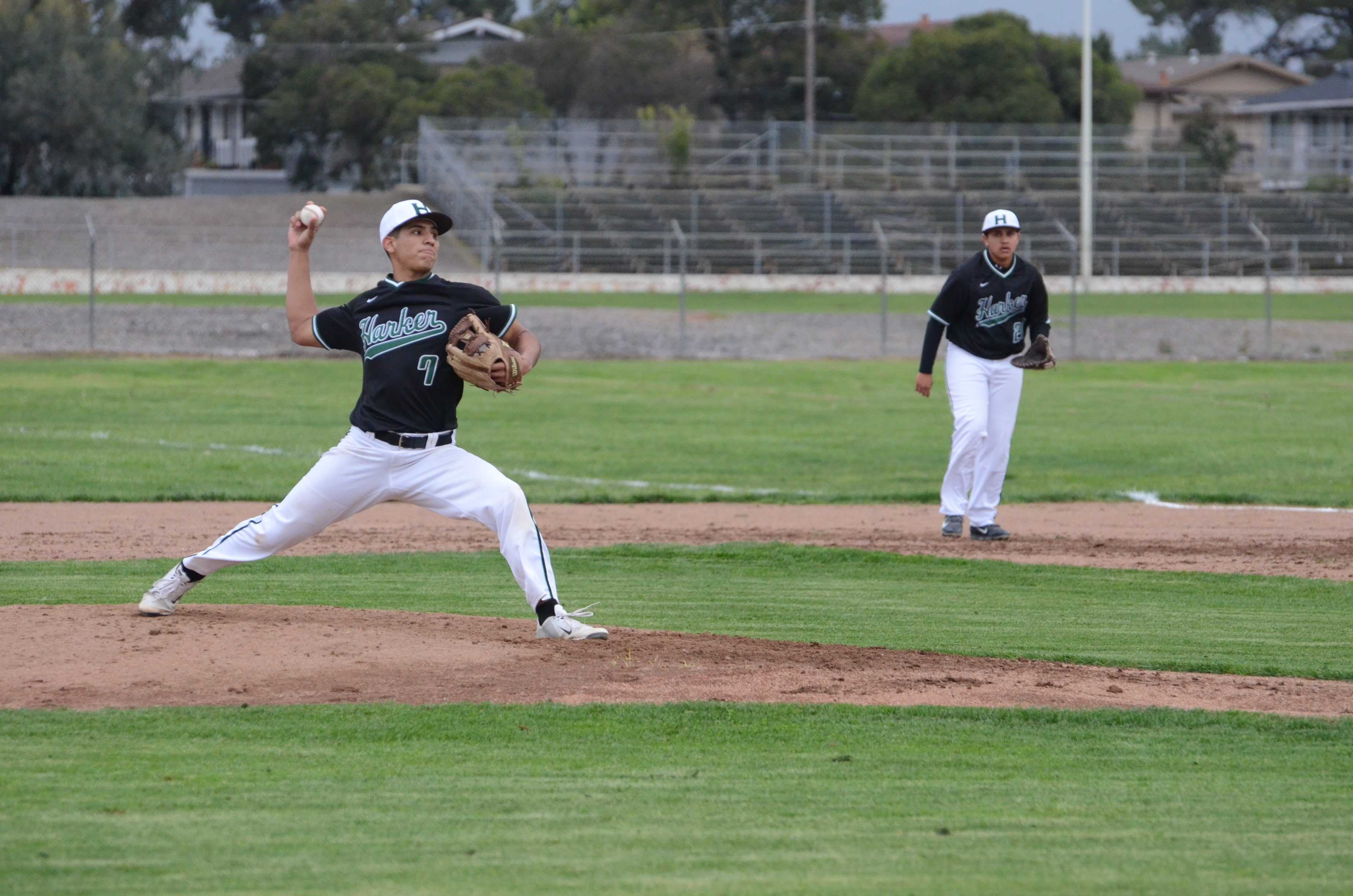 Nate Kelly (10) lunges forward in preparation to throw a pitch during the second inning. Nate was one of three Sophomores to pitch during the game, alongside Akhil Arun and Dominic Cea.