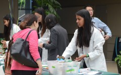 Anuva Mittal (11) demos an experiment at the 10th Symposium. This year, WiSTEM will introduce new interactive workshops.