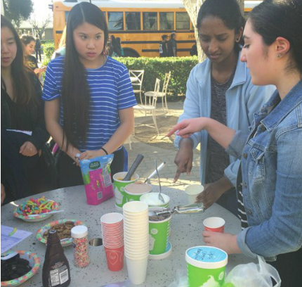 Seniors Nikita Ramoji and Ayla Ekici sell Pinkberry and other baked goods to raise funds for the Kenya Center for Excellence.