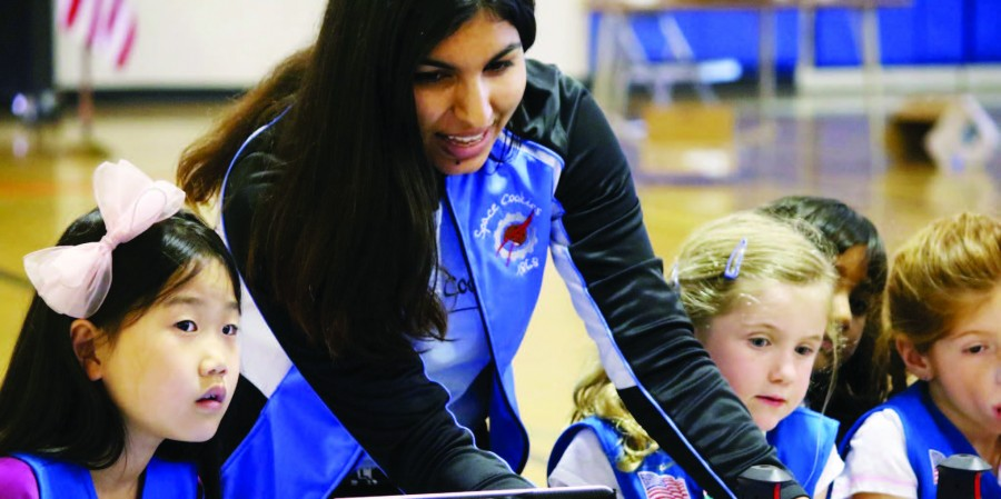 Shivali Minocha (12) instructs young girls on operating a robot at a Girl Scouts robotics demo. Shivali is currently Marketing & Outreach Captain at Space Cookies and a Girl Scouts ambassador.