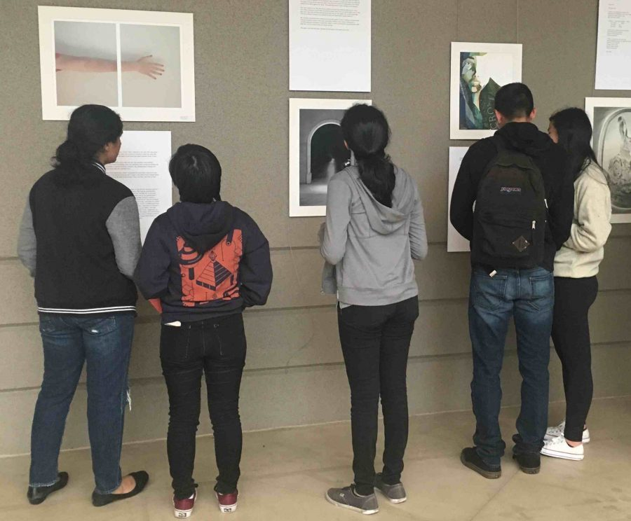Students view art and writing on display at the Artstravaganza today during long lunch. The event included a performance by Jazz Band, the unveiling of this year's issue of HELM magazine and readings by selected authors.